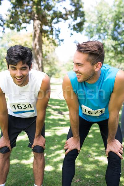 Maratón parque sonriendo masculina hablar Foto stock © wavebreak_media