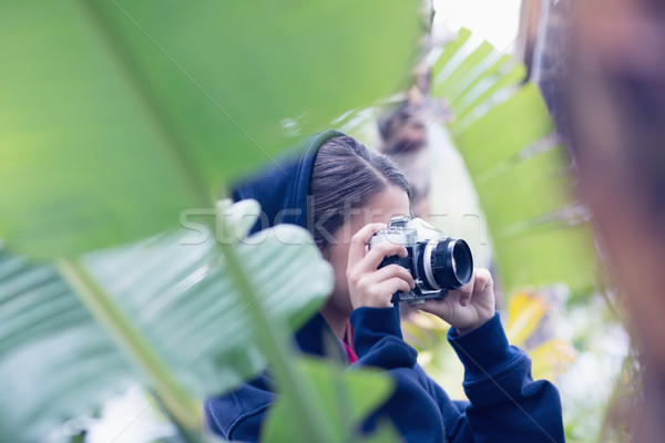 Young woman taking a picture in a forest Stock photo © wavebreak_media