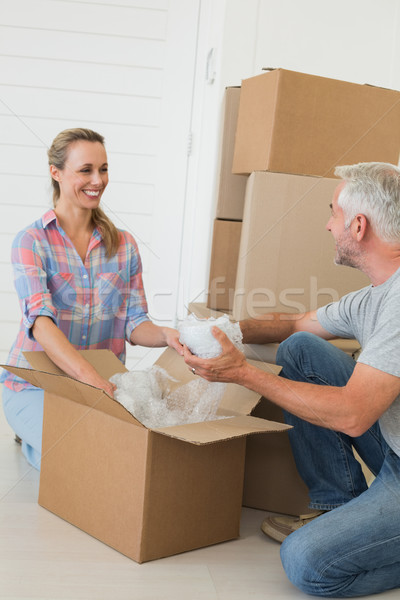 Happy couple unpacking cardboard moving boxes Stock photo © wavebreak_media