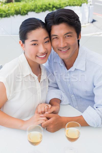 Feliz casal de mãos dadas vinho branco fora varanda Foto stock © wavebreak_media