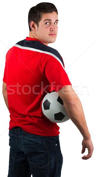 Football fan in red jersey holding ball Stock photo © wavebreak_media