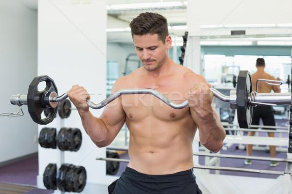 Shirtless focused bodybuilder lifting heavy barbell weight  Stock photo © wavebreak_media