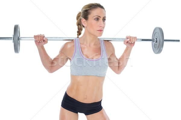 Forte femminile bilanciere dietro testa Foto d'archivio © wavebreak_media