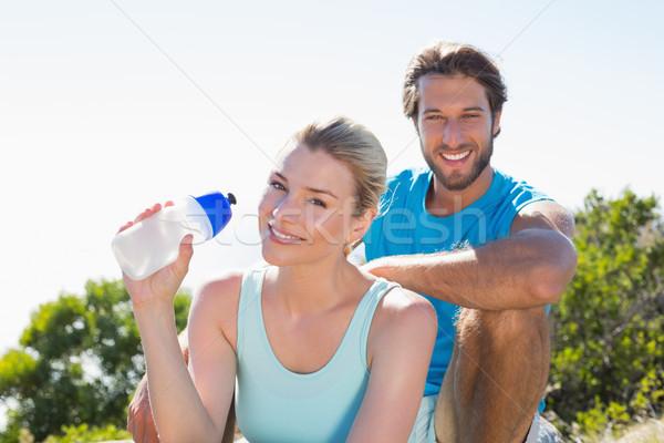 Dopasować para przerwie uśmiechnięty kamery Zdjęcia stock © wavebreak_media
