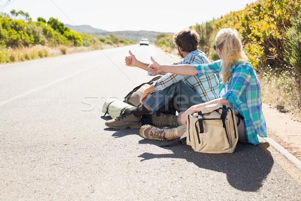 привлекательный пару сидят дороги походов Сток-фото © wavebreak_media