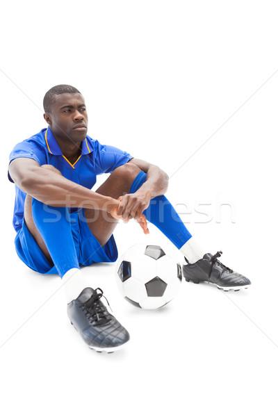 Futbolista sesión suelo pelota blanco Foto stock © wavebreak_media