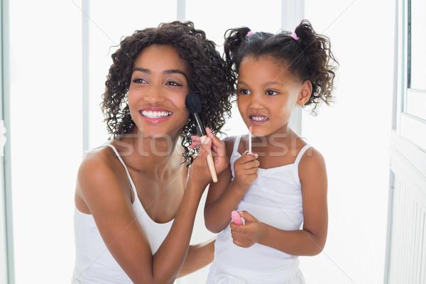 Bastante mãe ensino filha make-up casa Foto stock © wavebreak_media