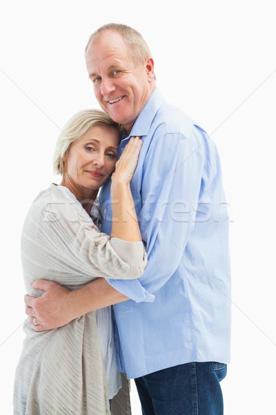 Happy mature couple hugging and smiling Stock photo © wavebreak_media