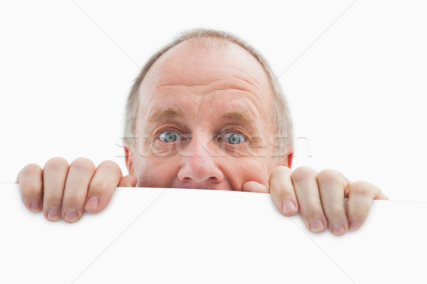 Mature man looking over card Stock photo © wavebreak_media