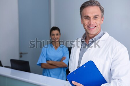 Dentist and assistant smiling at camera Stock photo © wavebreak_media