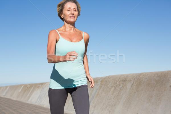 Aktív idős nő jogging móló napos idő Stock fotó © wavebreak_media