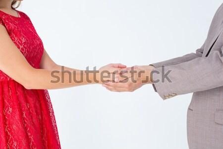 Pár kéz a kézben hátsó nézet fehér férfi piros Stock fotó © wavebreak_media