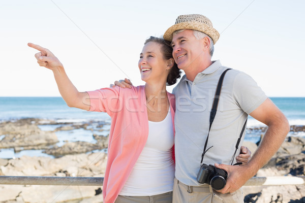 Happy casual couple looking at something by the coast Stock photo © wavebreak_media