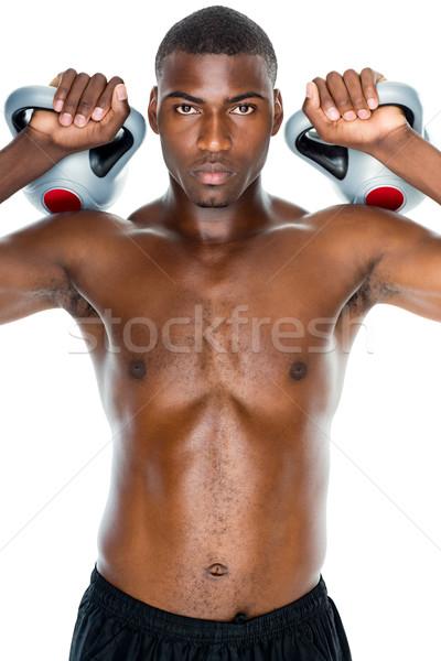 Póló nélkül fitt fiatalember emel bogrács test Stock fotó © wavebreak_media