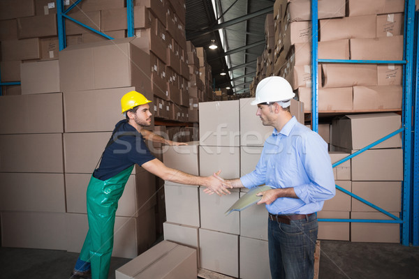 Warehouse worker loading up a pallet with manager Stock photo © wavebreak_media