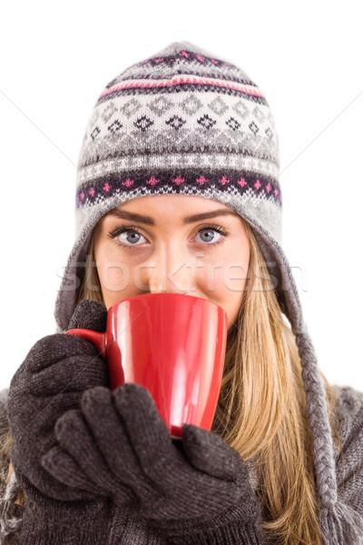 Happy blonde in winter clothes holding mug Stock photo © wavebreak_media