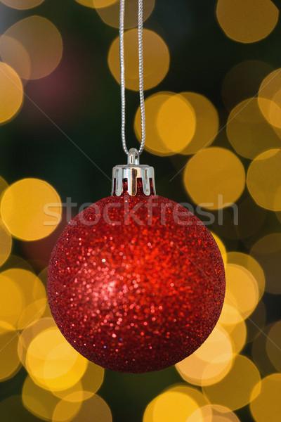 Czerwony christmas piłka dekoracji wiszący zamazany Zdjęcia stock © wavebreak_media