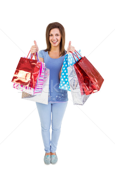Woman holding shopping bags with the thumbs up Stock photo © wavebreak_media