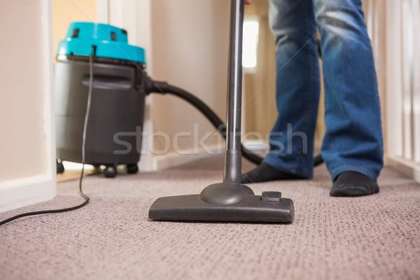 Close up a young man vacuuming Stock photo © wavebreak_media