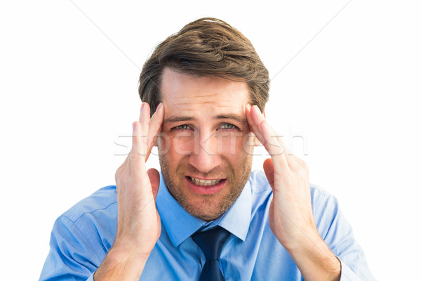 Young businessman with severe headache Stock photo © wavebreak_media