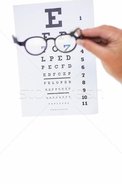 Foto stock: Mano · gafas · examen · de · la · vista · blanco