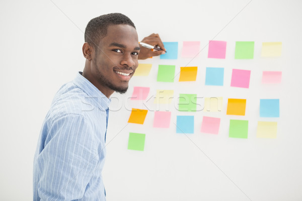 улыбаясь бизнесмен Дать служба стены Сток-фото © wavebreak_media
