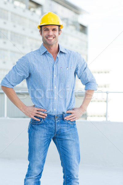 Happy male architect with hands on hips Stock photo © wavebreak_media
