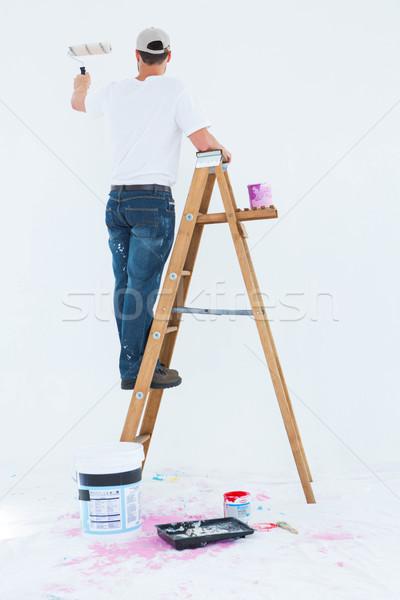 Férfi létra festmény teljes alakos hátsó nézet férfi Stock fotó © wavebreak_media