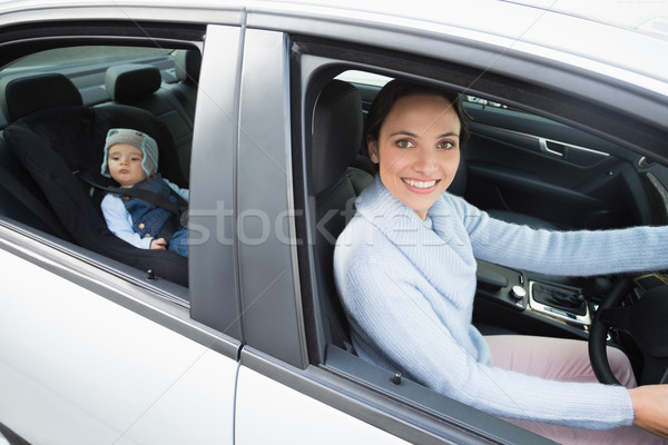 Mother driving with her baby in the car seat Stock photo © wavebreak_media