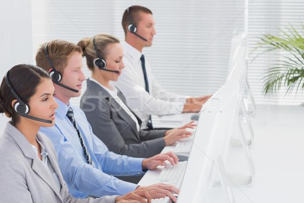 Equipe de negócios trabalhando informática call center homem Foto stock © wavebreak_media