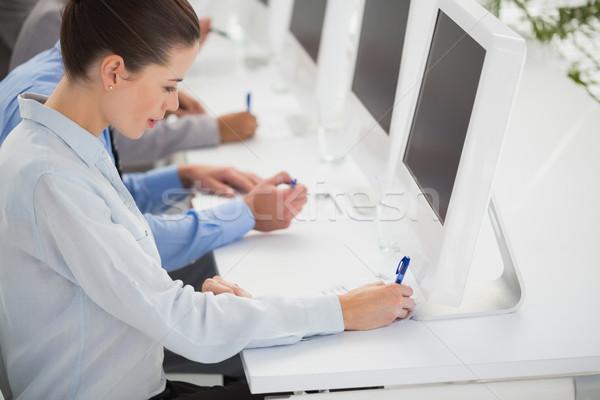 Zespół firmy piśmie burza mózgów pomysły notatnika biuro Zdjęcia stock © wavebreak_media