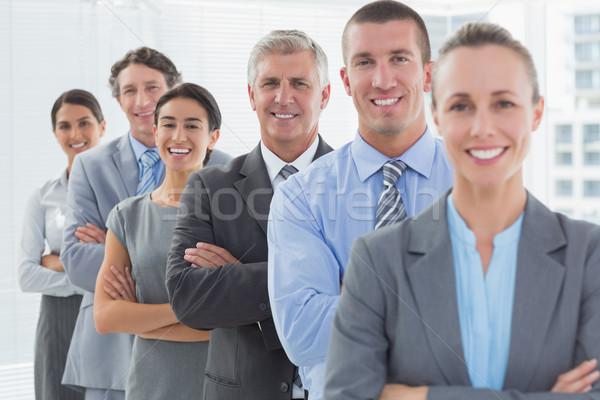 улыбаясь бизнес-команды Постоянный линия служба женщину Сток-фото © wavebreak_media