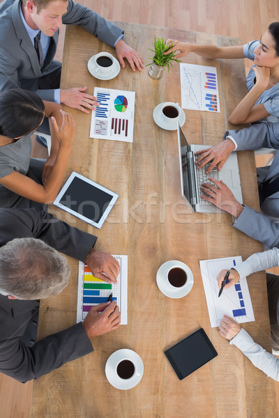 Business team discussing the graphs  Stock photo © wavebreak_media