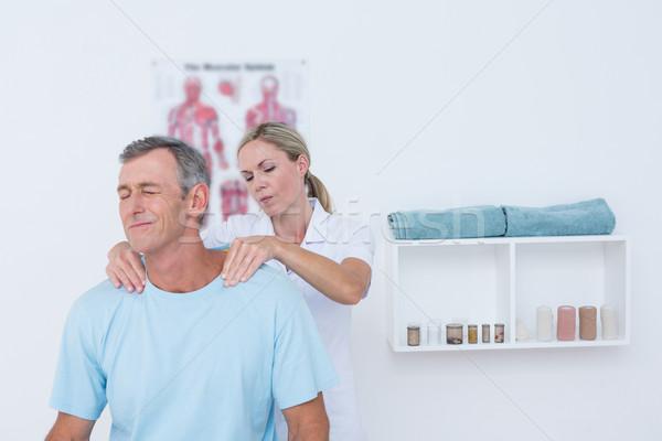 Médico paciente pescoço médico escritório Foto stock © wavebreak_media