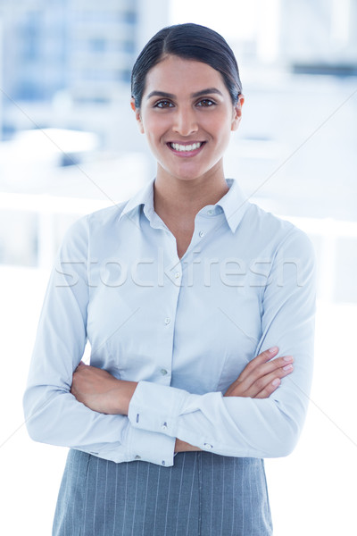 Smiling businesswoman with arms crossed at office Stock photo © wavebreak_media