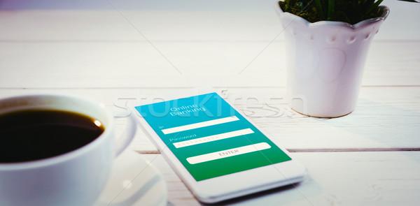Obraz online bankowego smartphone biurko Zdjęcia stock © wavebreak_media