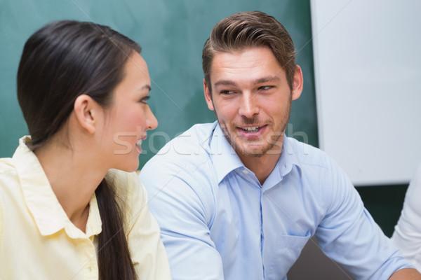 Derűs üzletemberek beszél együtt dolgozni iroda boldog Stock fotó © wavebreak_media