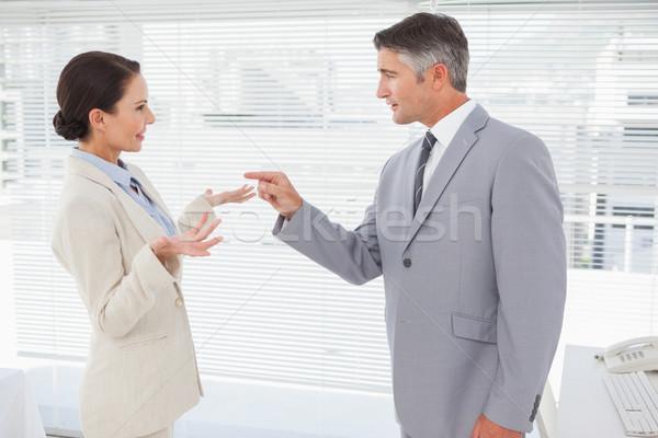 Businessman scolding his co worker Stock photo © wavebreak_media