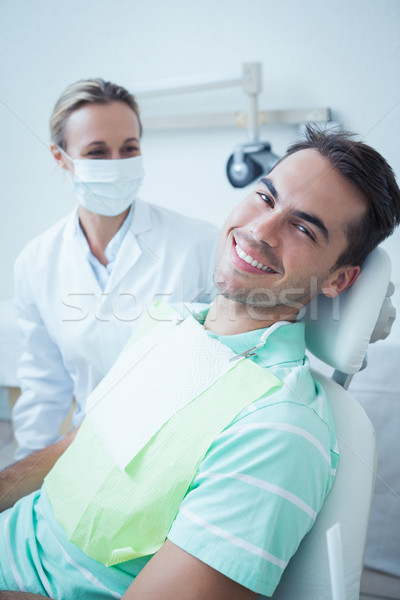 Sorridente moço espera dental exame retrato Foto stock © wavebreak_media