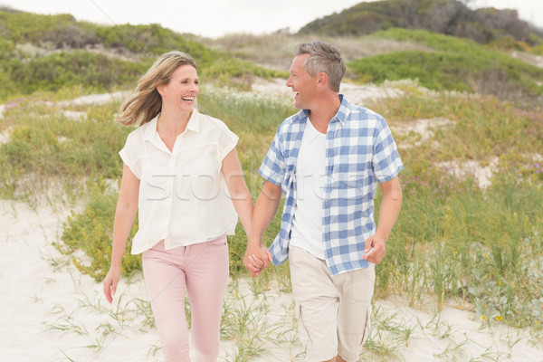 Casual couple walking holding hands Stock photo © wavebreak_media