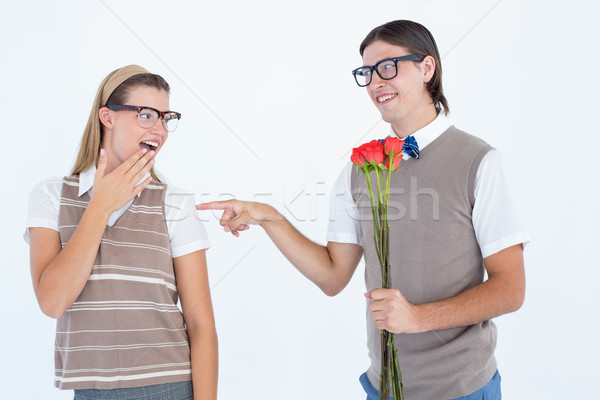 Geeky hipster offering red roses to his girlfriend  Stock photo © wavebreak_media