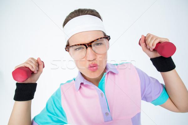 Hipszter lány emel súlyzók fehér fitnessz Stock fotó © wavebreak_media