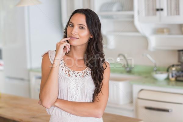Beautiful brunette looking at camera  Stock photo © wavebreak_media