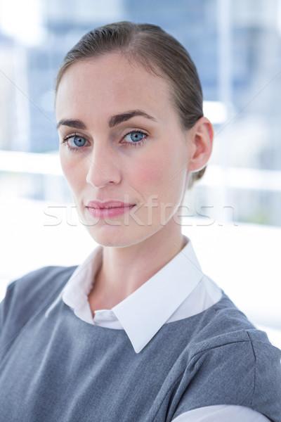 Focused businesswoman looking at the camera Stock photo © wavebreak_media