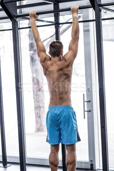 Muscular man doing pull up exercises Stock photo © wavebreak_media