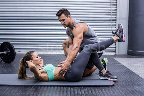 Stock photo: Muscular couple doing abdominal exercises