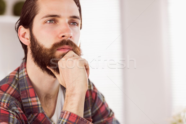 Hipster businessman thinking at his desk Stock photo © wavebreak_media