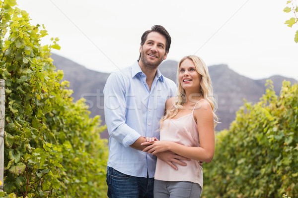 Fiatal boldog pár mosolyog néz távolság Stock fotó © wavebreak_media