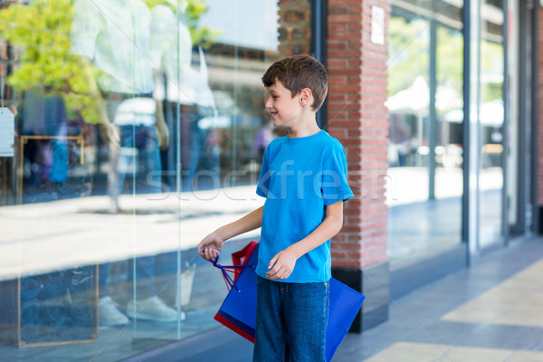 Young boy playing with shopping bags Stock photo © wavebreak_media
