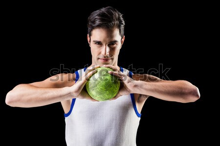 Composite image of portrait of happy athlete man holding ball  Stock photo © wavebreak_media
